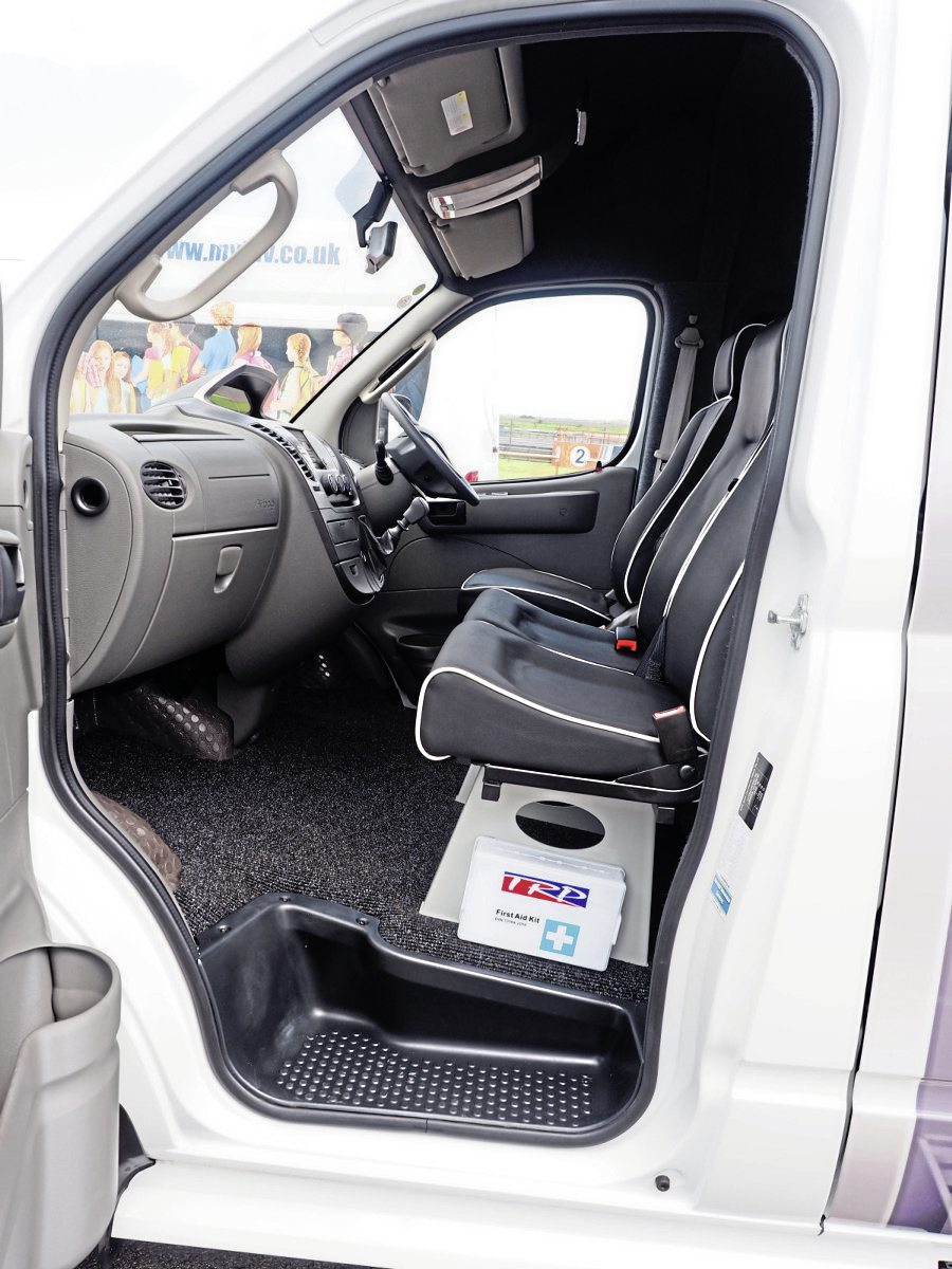 The conversion with sliding door access retains three front seats