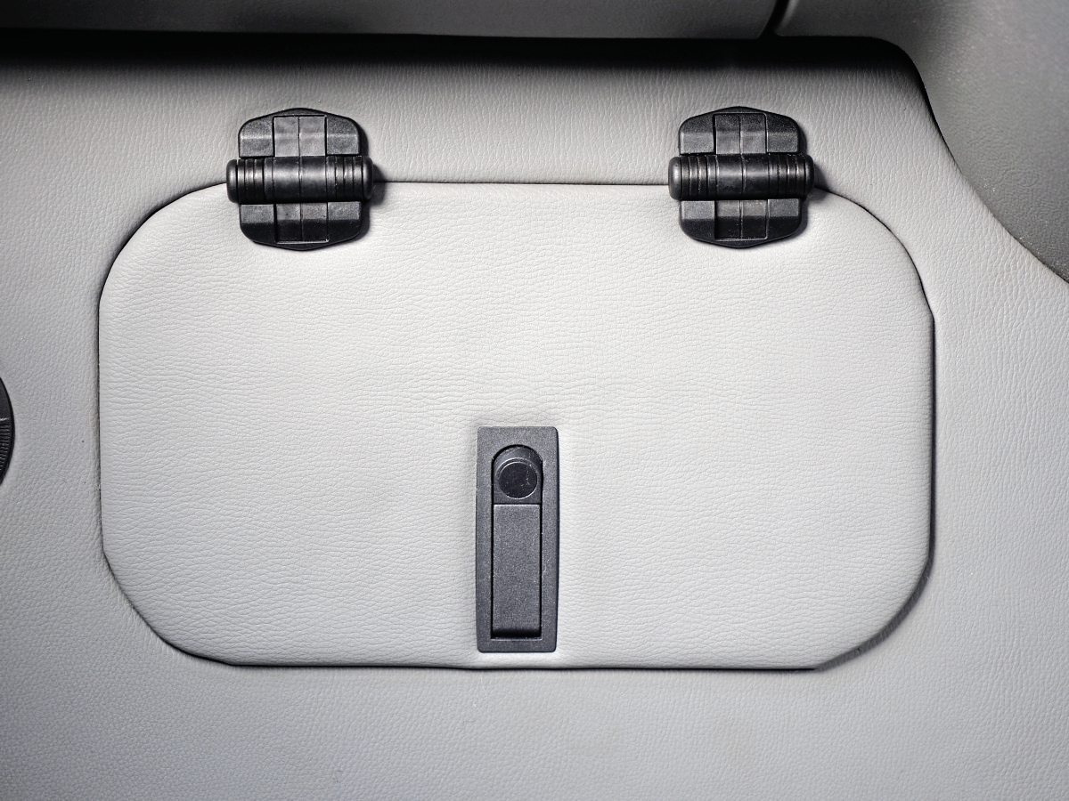 The converter has added a small locker and panel left of the driver position