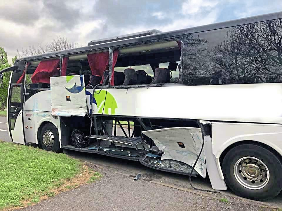 Bus and coach collide