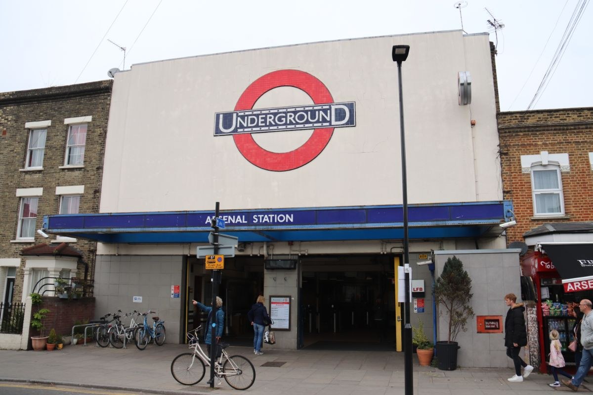 Arsenal Station frontage sits within a row of houses and shops