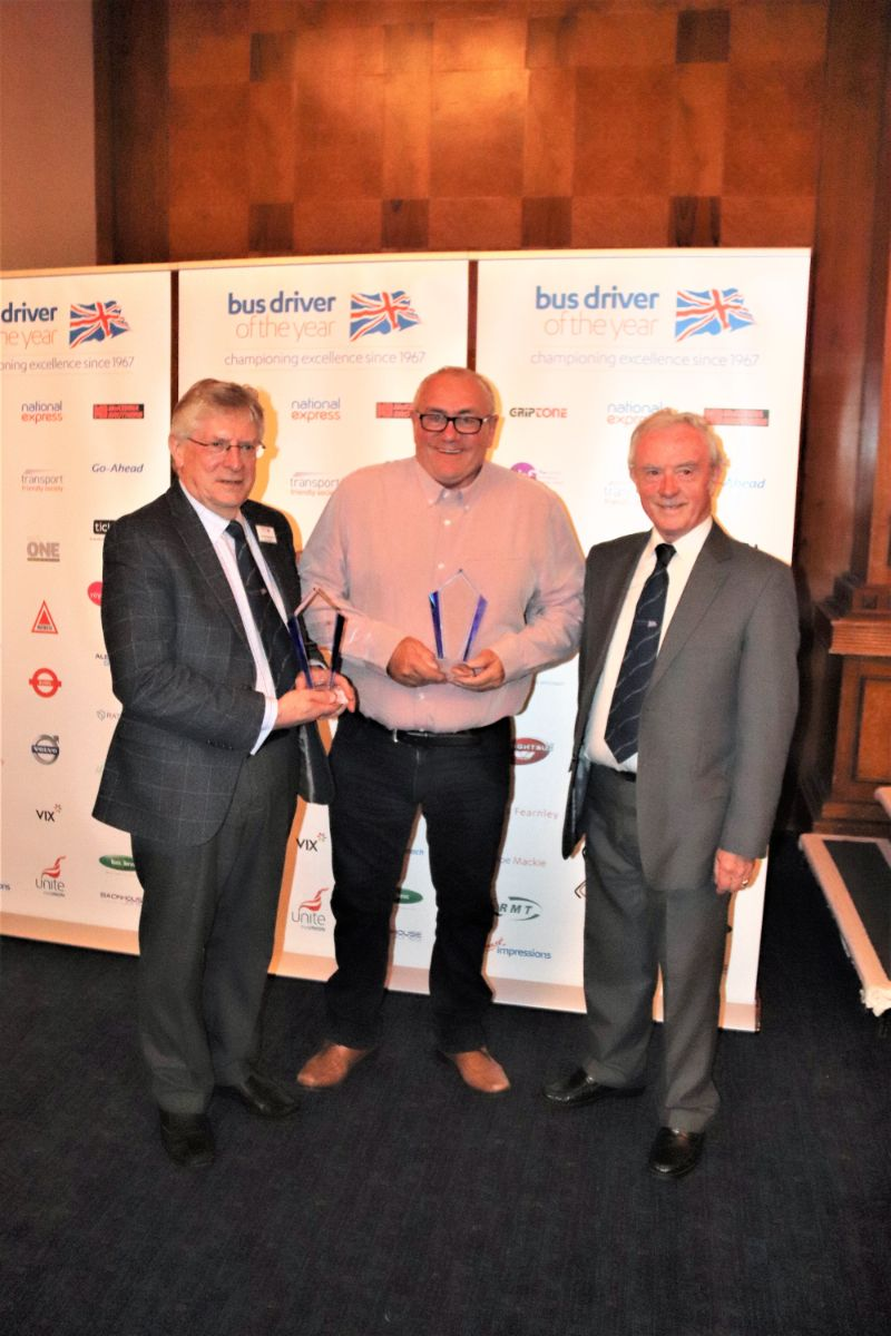 Andrew Braddock and Frank Llewellyn accept awards from Chairman, Joe Mackie, as they are standing down from Council this year
