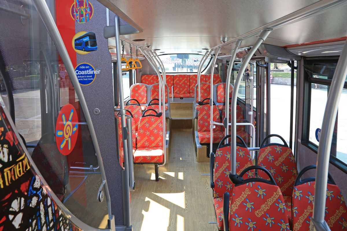 The lower deck refurbishment includes City Sightseeing pattern seat coverings and wood effect flooring
