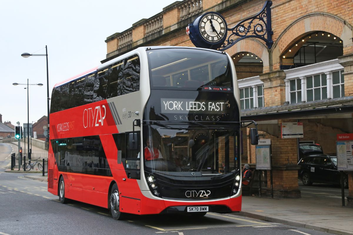 One of the new ADL Enviro400 MMCs in its Best Impressions Cityzap livery under the clock in York's soon to be remodelled station forecourt