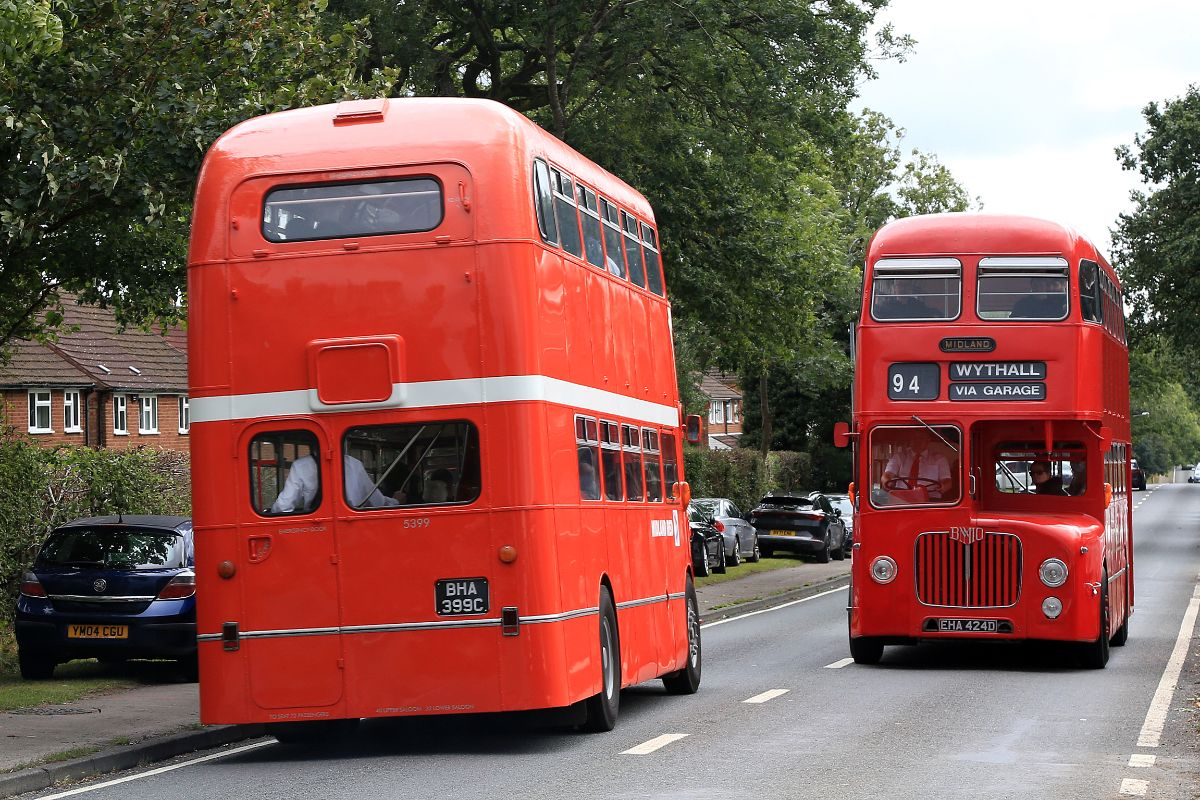 A total of 345 of these elegant D9 half-cab double deckers were built between 1958 and 1966 featuring BMMO's 10.5-litre engine. Here two in different liveries pass at the Maypole. The Museum has another restored example in WMPTE livery